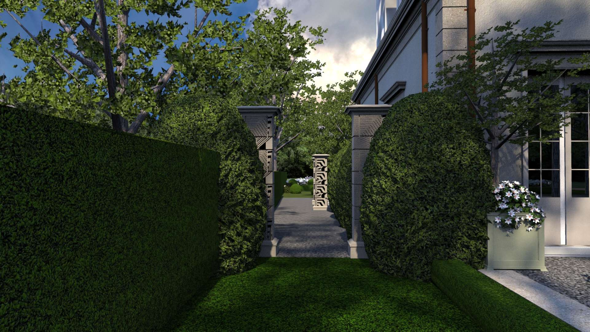 Indiana limestone columns support ornamental iron walk-through gates. Ornamental holly topiary rest on both sides of the gate and provide architectural softening and scale to the landscape..