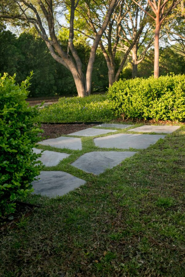 Silvermist flagstones are set with grass joints and create a transition from one area to the next.