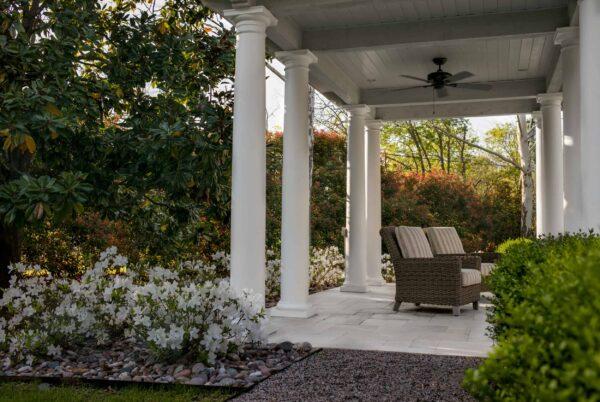 White Azaleas soften the edges of the covered pavilion's limestone floor.