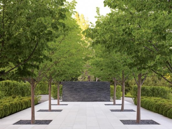 Gray stone wall featured as a sculptural element in this garden designed by Andrea Cochran.