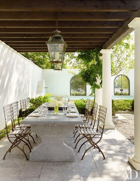 6. outdoor dining - stone table with wooden chairs