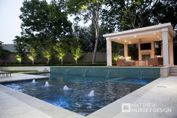 Contemporary Swimming Pool with spa and tanning deck