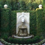Formal Traditional Garden with stone fountain and Barrel Cactus