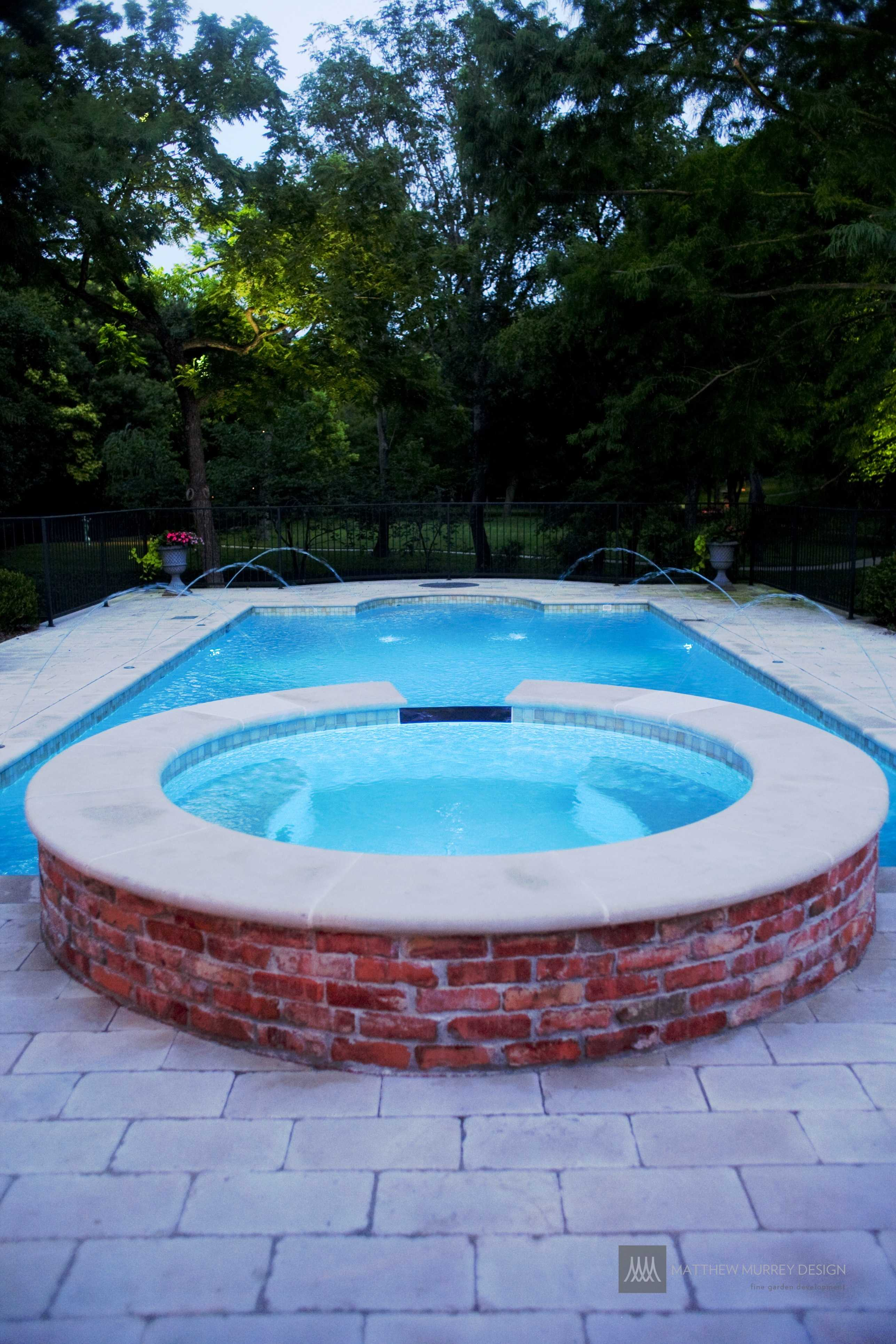 limestone coping and reclaimed brick pool and spa
